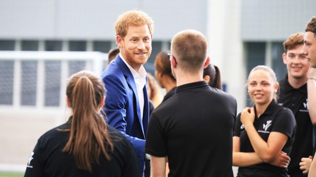 HRH Prince Harry meets Manchester City's Coach Core apprentices
