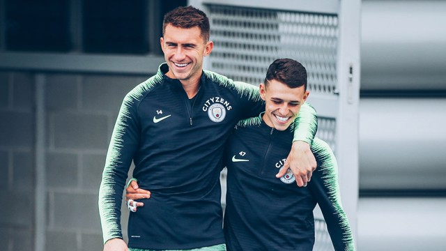 TEAM MATES: Aymeric Laporte and Phil Foden.