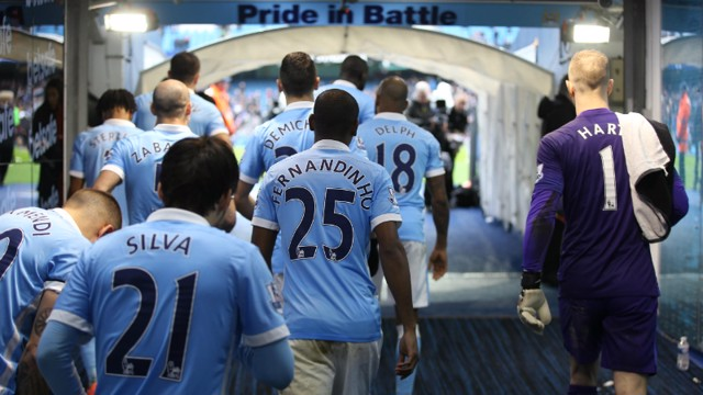 Manchester City players head out of the tunnel