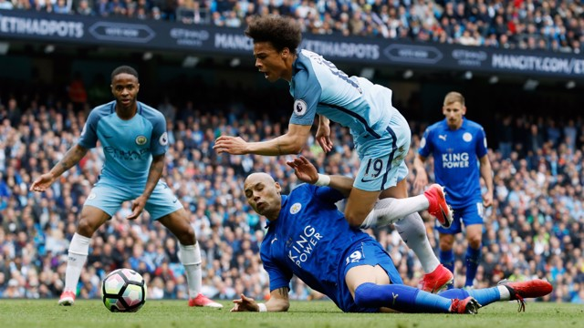 PENALTY!: Leroy Sane is brought down for the spot kick that led to City's second goal.