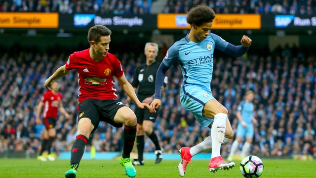 A CLOSE EYE: Sane is guarded by United's Ander Herrera in the first half.