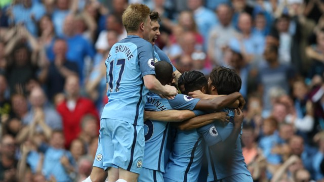 JUMPING FOR JOY: Kevin De Bruyne and John Stones join in the celebrations