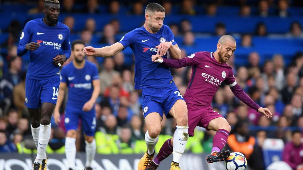 LEADING MAN: David Silva fends off Chelsea's Gary Cahill