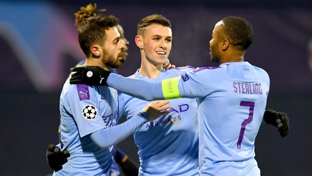 GROUP HUG: Phil Foden celebrates City's fourth.
