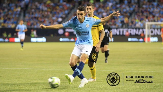 UNDER PRESSURE: Phil Foden aims his pass